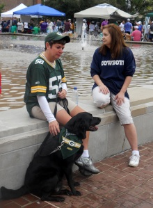 Green Bay Packer and Cowboys fans with their dog