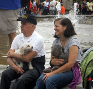 Two poodles with their owners